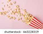 popcorn in red and white...   Shutterstock . vector #663228319