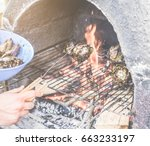young man cooking stuffed... | Shutterstock . vector #663233197