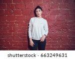 attractive brunette in a gray... | Shutterstock . vector #663249631