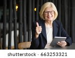 happy senior woman with tablet... | Shutterstock . vector #663253321