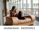 girl listening to music through ... | Shutterstock . vector #663253411
