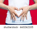 young woman who makes a heart... | Shutterstock . vector #663262105