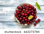 Fresh cherry on plate on wooden ...