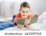 little boy reading a book. the... | Shutterstock . vector #663295765