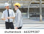 two engineer look to target at... | Shutterstock . vector #663299287