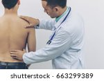 doctor touches the back plate...   Shutterstock . vector #663299389