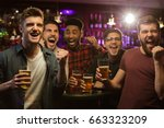 four happy men holding beer... | Shutterstock . vector #663323209