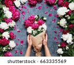 top view of hands of young... | Shutterstock . vector #663335569