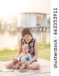 young mother teaching her baby... | Shutterstock . vector #663353911