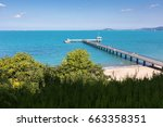 long bridge in the blue sea | Shutterstock . vector #663358351