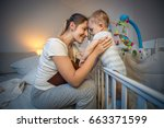 happy young mother looking at... | Shutterstock . vector #663371599