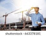 engineer and power crane in the ... | Shutterstock . vector #663378181