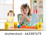 preschooler girl having fun... | Shutterstock . vector #663387679