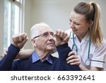 nurse assessing stroke victim... | Shutterstock . vector #663392641