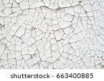 cracked white paint on a wall... | Shutterstock . vector #663400885