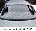 Small photo of a crashed car heated rear window broken by an accidentally cast stone