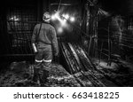 miner in a coal mine. mining | Shutterstock . vector #663418225