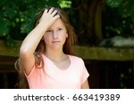 young teenage girl in the park... | Shutterstock . vector #663419389