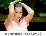 young teenage girl in the park... | Shutterstock . vector #663419479