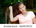 young teenage girl in the park... | Shutterstock . vector #663419521