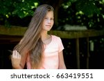 young teenage girl in the park... | Shutterstock . vector #663419551