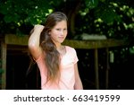 young teenage girl in the park... | Shutterstock . vector #663419599