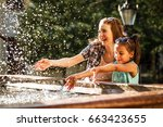 mother and daughter playing in... | Shutterstock . vector #663423655