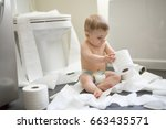 a toddler ripping up toilet... | Shutterstock . vector #663435571