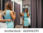 photo of two young women trying ... | Shutterstock . vector #663446194