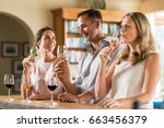 mature friends tasting red and...   Shutterstock . vector #663456379