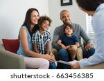 happy young family sitting on... | Shutterstock . vector #663456385