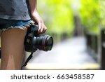 female photographer | Shutterstock . vector #663458587