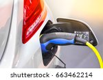 electric car charging on... | Shutterstock . vector #663462214