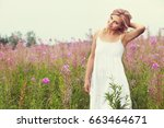 outdoor portrait of a beautiful ... | Shutterstock . vector #663464671