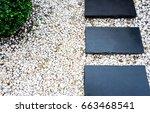 black rocks walking way in...   Shutterstock . vector #663468541
