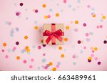 present box with red bow on... | Shutterstock . vector #663489961