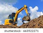 the modern excavator  performs... | Shutterstock . vector #663522271