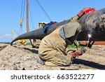 welder on the pipeline repairs.  | Shutterstock . vector #663522277