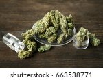 heap of weed buds and glassware ... | Shutterstock . vector #663538771