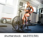 woman at the crossfit gym using ... | Shutterstock . vector #663551581