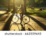 Girl On A Bicycle In A Park...