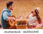 picnic time. young couple... | Shutterstock . vector #663561445