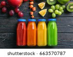 different juices in bottles... | Shutterstock . vector #663570787