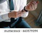 men wear cufflinks on a shirt... | Shutterstock . vector #663579394