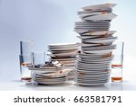stacks of dirty dishes. | Shutterstock . vector #663581791