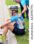 Small photo of STILLWATER, MINNESOTA/USA - JUNE 18, 2017: Lily Williams wins the Women's Best Amateur classification of the North Star Grand Prix and rests after completing the final stage of the pro cycling race.