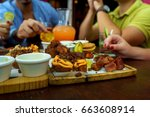 people eating burger in a...   Shutterstock . vector #663608914