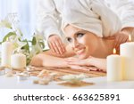 young woman having massage | Shutterstock . vector #663625891