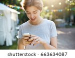 girl using smart phone.... | Shutterstock . vector #663634087