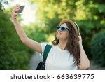 traveler using smartphone...   Shutterstock . vector #663639775